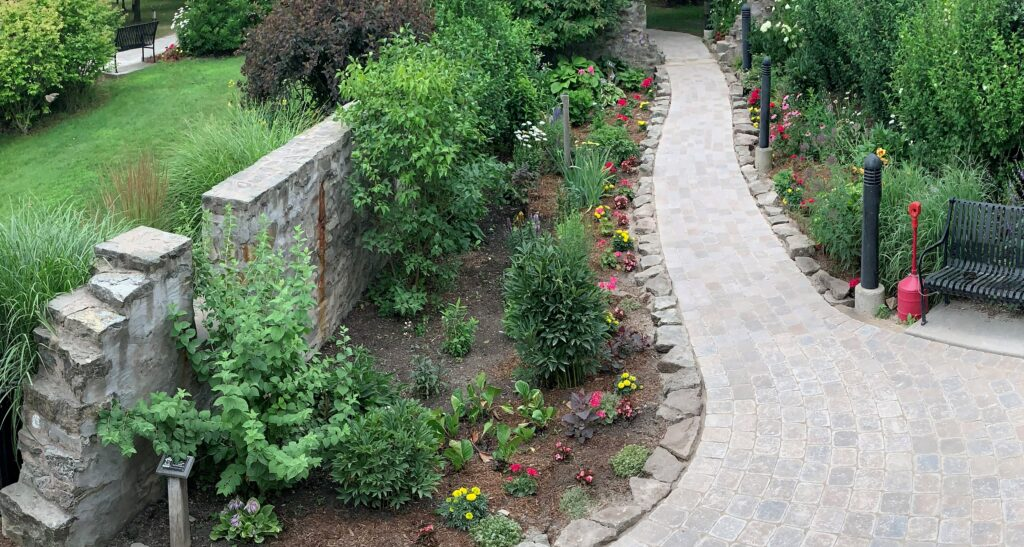 This image has an empty alt attribute; its file name is Pathway-in-walled-garden-2-1024x547.jpeg